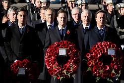 © London News Pictures. 10/11/2013. London, UK. L to R  Ed Miliband (Labour Party Leader), Nick Clegg (Deputy Prime Minister) and David CAmeron (British Prime Minister) holding wreaths in front of previous British Prime ministers Gordon Brown (back left), Tony Blair (Back centre) and John Major (back right) during a Remembrance Day Ceremony at the Cenotaph war memorial in London, United Kingdom, on November 10, 2013 . Royalty and Politicians joined the rest of the county in honouring the war dead by gathering at the iconic memorial to lay wreaths and observe two minutes silence. Photo Credit: Ben Cawthra/LNP