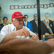 MIAMI, FLORIDA, APRIL 22, 2017<br /> Francisco Perez, 75,  as he plays dominoes  in Miami's Little Havana neighborhood's Maximo Gomez Domino Park. Many Miami Cubans voted for Donald Trump in the general elections. Trump will soon complete his first 100 days as United States President.<br /> (Photo by Angel Valentin/Freelance)