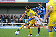 Rochdale FC midfielder Matthew Lund (8) challenges AFC Wimbledon midfielder Chris Whelpdale (11) during the EFL Sky Bet League 1 match between Rochdale and AFC Wimbledon at Spotland, Rochdale, England on 27 August 2016. Photo by Stuart Butcher.