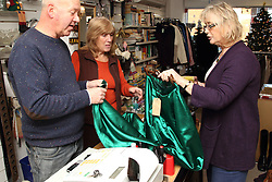 Volunteers and customer at Mysight charity shop.