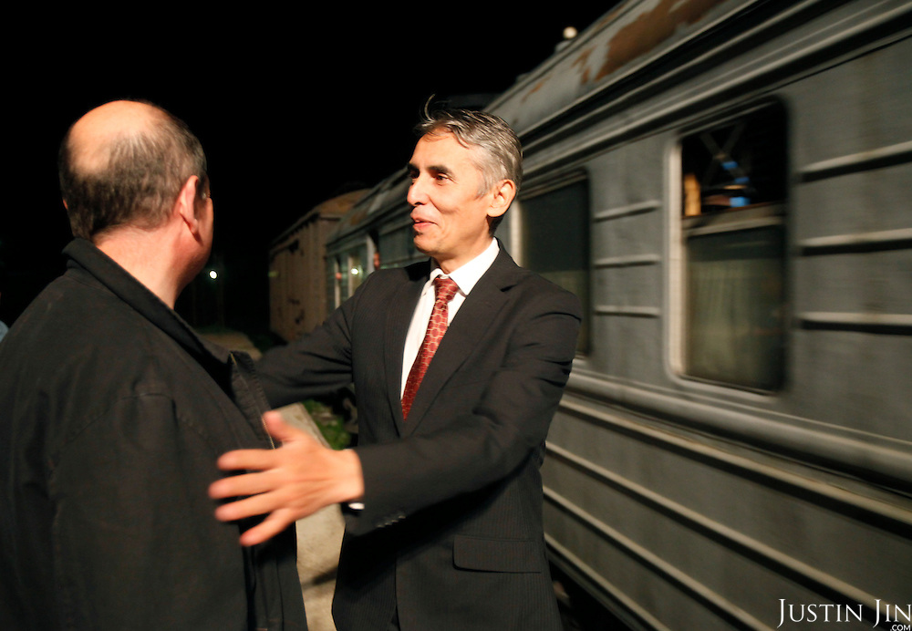 Adil Tuleushev, director of Kazakhstan's Institute of Nuclear Physics, shakes hands with American-Ukrainian physicist Igor Bolshinsky as an armoured train carrying highly enriched uranium pulls away from Almaty, Kazakhstan, where the radioactive substance will be brought to Russia for downgrading. .The removal of Kazakhstan's highly enriched uranium (HEU) is part of the U.S. Global Threat Reduction Initiative (GTRI), where Igor Bolshinsky and Kelly Cummins work, that tries to secure nuclear material around the world to prevent their misuse by terrorists and rogue states.