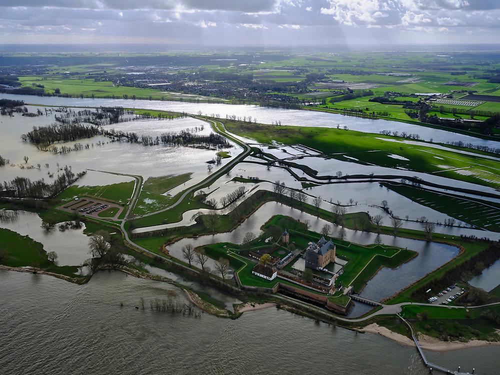 Nederland, Gelderland, Gemeente Zaltbommel; 25-02-2020; Poederoijen, kasteel en fort Loevestein bij hoogwater. Slot Loevestein is strategisch gelegen op de plaats waar Waal en Maas in het verleden samenkwamen (nu Afgedamde Maas). Loevestein maakt deel uit van de Hollandse Waterlinie.<br /> Loevestein castle at high waters is strategically located at the place where Waal and Meuse in the past came together. Loevestein is part of the Holland Waterline (defense line).<br /> <br /> luchtfoto (toeslag op standard tarieven);<br /> aerial photo (additional fee required)<br /> copyright © 2020 foto/photo Siebe Swart