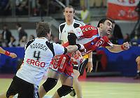 Handball EM Herren 2010 Vorrunde Deutschland - Polen 19.01.2010 Oliver Roggisch (GER links) gegen Bartosz Jurecki (POL)