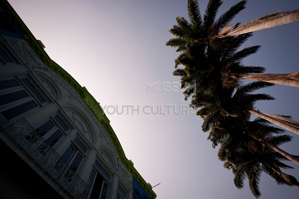PALM TREES AND COLONIAL BUILDING AGAINST A BRIGHT BLUE SKY SANTA TEREASA RIO