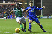 Stephane Omeonga and Ryan Jack challenge for the ball  during the Ladbrokes Scottish Premiership match between Hibernian and Rangers at Easter Road, Edinburgh, Scotland on 8 March 2019.
