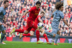 LIVERPOOL, ENGLAND - Sunday, May 11, 2014: Liverpool's captain Steven Gerrard and Luis Suarez in action against Newcastle United during the Premiership match at Anfield. (Pic by David Rawcliffe/Propaganda)