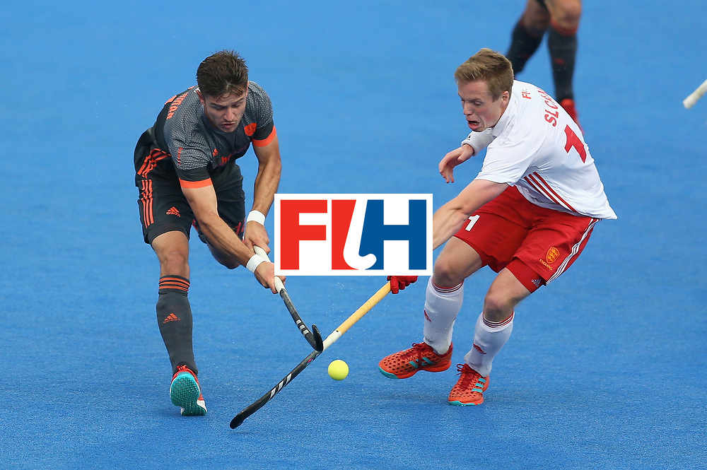 LONDON, ENGLAND - JUNE 24: Robbert Kemperman of the Netherlands and Ian Sloan of England battle for possession during the semi-final match between England and the Netherlands on day eight of the Hero Hockey World League Semi-Final at Lee Valley Hockey and Tennis Centre on June 24, 2017 in London, England. (Photo by Steve Bardens/Getty Images)