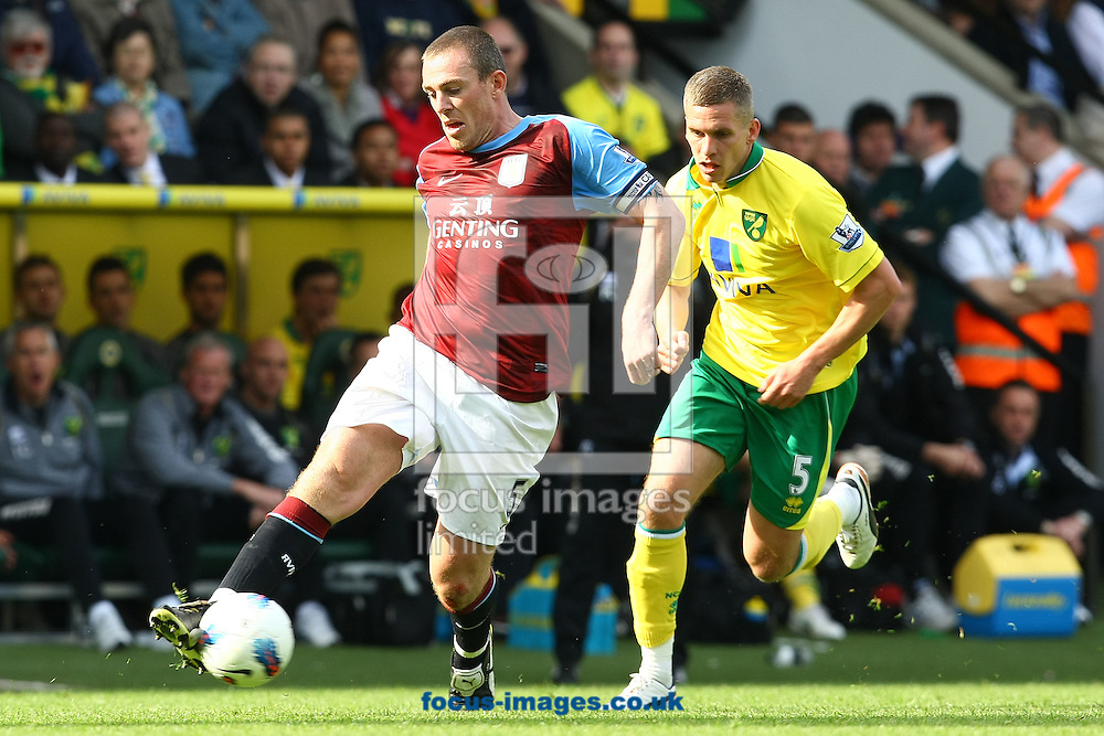 Picture by Paul Chesterton/Focus Images Ltd.  07904 640267.13/05/12.Richard Dunne of Aston Villa and Steve Morison of Norwich in action during the Barclays Premier League match at Carrow Road Stadium, Norwich.