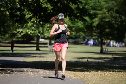 Image ©Licensed to i-Images Picture Agency. 16/07/2014. London, United Kingdom. Bright and hot day with max. temperatures of 27ºC. Regent\'s Park. A woman does jogging in a sunny and hot day in central London. Picture by Daniel Leal-Olivas / i-Images