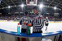 KELOWNA, CANADA - FEBRUARY 17:  Linesmen Cody Wanner and Dustin Minty stand at the bench during time out on February 17, 2018 at Prospera Place in Kelowna, British Columbia, Canada.  (Photo by Marissa Baecker/Shoot the Breeze)  *** Local Caption ***