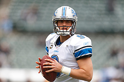 Dec 18, 2011; Oakland, CA, USA; Detroit Lions quarterback Matthew Stafford (9) warms up before the game against the Oakland Raiders at O.co Coliseum. Mandatory Credit: Jason O. Watson-US PRESSWIRE