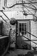 Detail of abandoned white brick building entrance, located near downtown Reidsville, North Carolina.