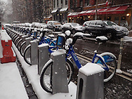 Citi Bikes on a snowy day on 85th street between Third and Second Avenue.