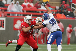31 October 2015:  Dan Pawlak(76) works to keep Tre Roberson(5) safe from defender Conlan Cassidy(99) during the NCAA FCS Football between Indiana State Sycamores and Illinois State Redbirds at Hancock Stadium in Normal IL (Photo by Alan Look)