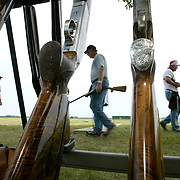 Shooters change positions during competition in the 2004 Iowa State Shoot in Cedar Falls.  The competition drew more than 800 trap shooters as far away as Australia.