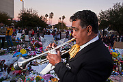 "15 JANUARY 2011 - TUCSON, AZ: RUBEN MORENO, from the Mariachi group Luz de Luna (Light of the Moon) performs at the memorial on the lawn in front of the University Medical Center in Tucson, AZ, Saturday, January 15. The memorial has been growing since the mass shooting last week. Six people were killed and 14 injured in the shooting spree at a ""Congress on Your Corner"" event hosted by Congresswoman Gabrielle Giffords at a Safeway grocery store in north Tucson on January 8. Congresswoman Giffords, the intended target of the attack, was shot in the head and seriously injured in the attack. She is hospitalized at UMC. Hospital staff have told the musicians that their music can be heard in Giffords' room. The alleged gunman, Jared Lee Loughner, was wrestled to the ground by bystanders when he stopped shooting to reload the Glock 19 semi-automatic pistol. Loughner is currently in federal custody at a medium security prison near Phoenix.  Photo by Jack Kurtz"
