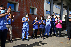 © Licensed to London News Pictures. 05/07/2020. London, UK. NHS staff at North Middlesex Hospital, Edmonton in north London take part in 'Clap For Our Carers' by applauding key workers. The final 'Clap for Our Carers' coincides with the 72nd birthday of the NHS. The campaign had encouraged people across the UK to take part in a round of applause from their windows, doors and front gardens to show their appreciation for the efforts of the NHS staff, carers and key workers during the COVID-19 pandemic. Photo credit: Dinendra Haria/LNP