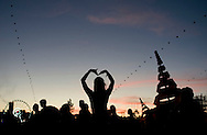 The sun sets on the second day of the 2013 Coachella Valley Music and Arts Festival in Indio, Calif. Saturday.