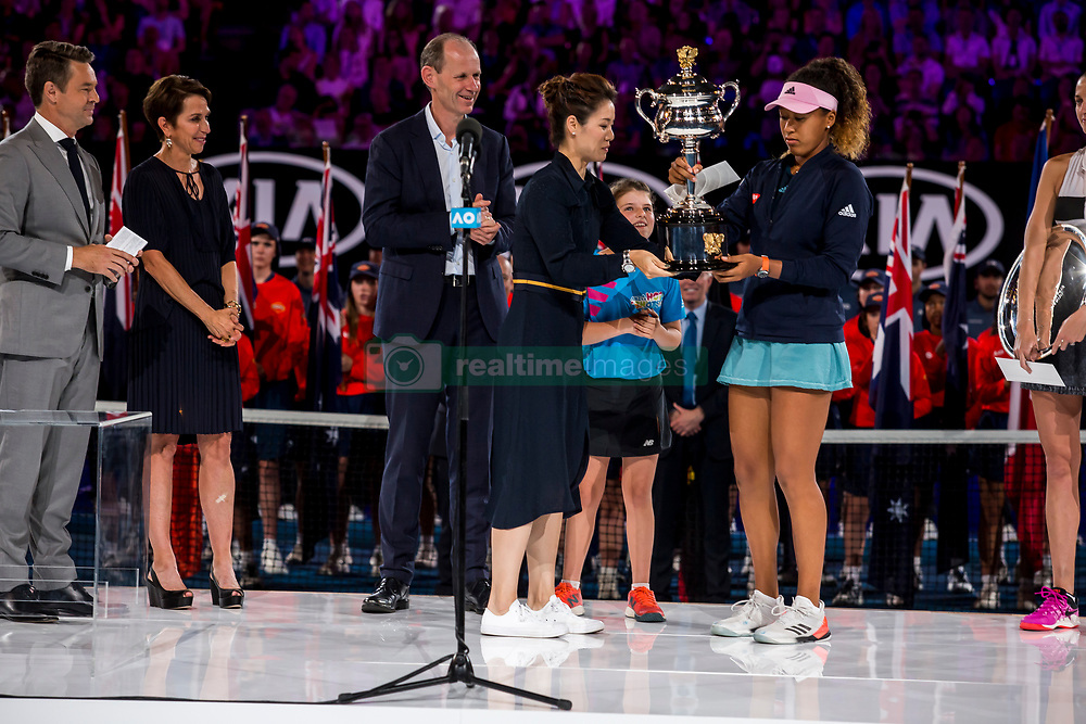 January 26, 2019 - Melbourne, VIC, U.S. - MELBOURNE, AUSTRALIA - JANUARY 26 : Naomi Osaka of ÊJapan is presented with her trophy by Li Na of China after winning the final on day 13 of the Australian Open on January 26 2019, at Melbourne Park in Melbourne, Australia.(Photo by Jason Heidrich/Icon Sportswire) (Credit Image: © Jason Heidrich/Icon SMI via ZUMA Press)