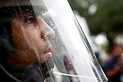 Law enforcement officers hold their positions barracading streets as protesters march nearby during the 2012 Republican National Convention on August 27, 2012 in Tampa, Fla.