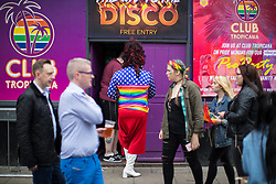 © Licensed to London News Pictures . 25/08/2017. Manchester , UK. People in Manchester's Gay Village at the opening night of Manchester Pride's Big Weekend . The annual festival , which is the largest of its type in Europe , celebrates LGBT life . Photo credit: Joel Goodman/LNP