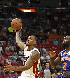 October 24, 2018 - Miami, FL, USA - The Miami Heat's Rodney McGruder, left, drives pass the New York Knicks' Tim Hardaway Jr. to the basket in the first half on Wednesday, Oct. 24, 2018, at the American Airlines Arena in Miami. The Heat won, 110-88. (Credit Image: © Carl Juste/Miami Herald/TNS via ZUMA Wire)