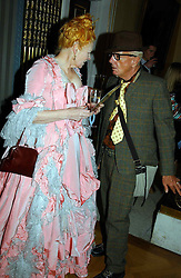 Fashion designer VIVIENNE WESTWOOD and NICKY HASLAM at a reception to open an exhibition entitled 'Boucher Seductive Visions' at The Wallace Collection, Manchester Square, London W1 on 29th September 2004.NON EXCLUSIVE - WORLD RIGHTS