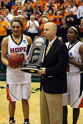 20 March 2010: Carrie Snikkers, Coach Brian Morehouse and Philana Greene stand with the trophy and game ball. The Flying Dutch of Hope College fall to the Bears of Washington University 65-59 in the Championship Game of the Division 3 Women's NCAA Basketball Championship the at the Shirk Center at Illinois Wesleyan in Bloomington Illinois.