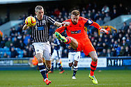 Matthew Mills of Bolton Wanderers (right)  clears the ball from Steve Morison of Millwall (left) during the Sky Bet Championship match at The Den, London<br /> Picture by David Horn/Focus Images Ltd +44 7545 970036<br /> 15/02/2014
