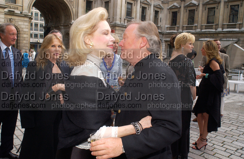 Lynn Wyatt and Sir Anthony Bamford, Around the World in One night, gala to raise money for the Royal Academy,   Royal Academy. 21 June 2004. ONE TIME USE ONLY - DO NOT ARCHIVE  © Copyright Photograph by Dafydd Jones 66 Stockwell Park Rd. London SW9 0DA Tel 020 7733 0108 www.dafjones.com