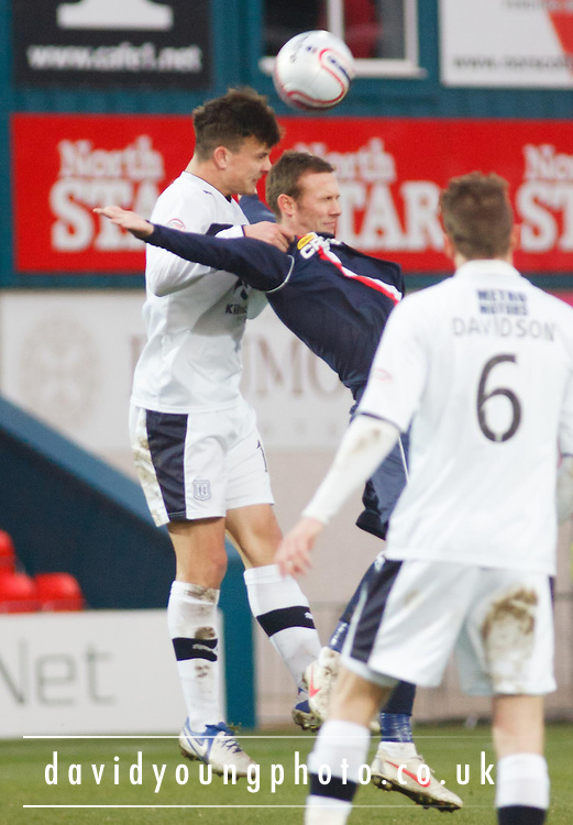 Dundee's Kyle Benedictus  beats Ross County's Colin McMenamin  in the air - Ross County v Dundee, Clydesdale Bank Scottish Premier League at Victoria Park, Dingwall.. - © David Young - www.davidyoungphoto.co.uk - email: davidyoungphoto@gmail.com