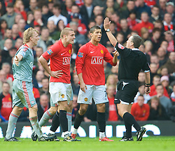 MANCHESTER, ENGLAND - Saturday, March 14, 2009: Manchester United's Nemanja Vidic is shown the red card by referee Alan Wiley and is sent off against Liverpool during the Premiership match at Old Trafford. (Photo by David Rawcliffe/Propaganda)