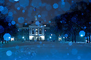 A heavy snowfall blankets Bascom Hill and Bascom Hall at the University of Wisconsin-Madison during a cold winter night on Feb. 15, 2006. The bright, out-of-focus spots in the sky are the result of blue-gelled light from an on-camera flash reflecting off snowflakes falling in the foreground.