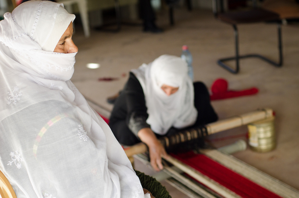 Bedouin women at the Sidreh weaving co-operative in Lakiya, Israel. The co-op provides jobs to local women, and uses its profits to support women's literacy and health projects in Bedouin villages in the Negev desert.