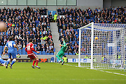 Middlesbrough FC striker Enrique Garcia Kike scores the opening goal during the Sky Bet Championship match between Brighton and Hove Albion and Middlesbrough at the American Express Community Stadium, Brighton and Hove, England on 19 December 2015. Photo by Phil Duncan.