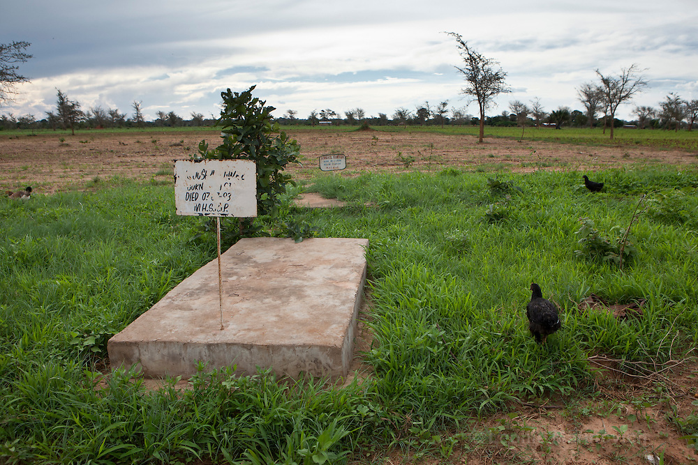 14 December 2010, Mazabuka District, Zambia. Mbiya Farm. Family graves are positioned right next to the yard of Ireen Hamvunga.