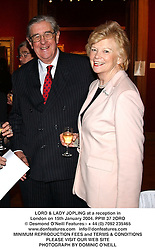 LORD & LADY JOPLING at a reception in London on 15th January 2004.PPW 37 2ORO