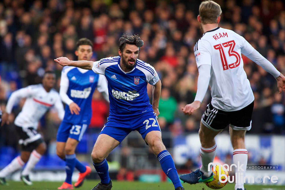 Ipswich, Suffolk. Football action from Ipswich Town v Fulham at Portman Road in the Sky Bet Championship on the 26th December 2016. Ipswich Town player Jonathan Douglas  against Fulham's Tim Ream.<br /> <br /> Picture: MARK BULLIMORE