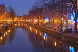 Reflections on oudezijds voorburgwal canal at twilight