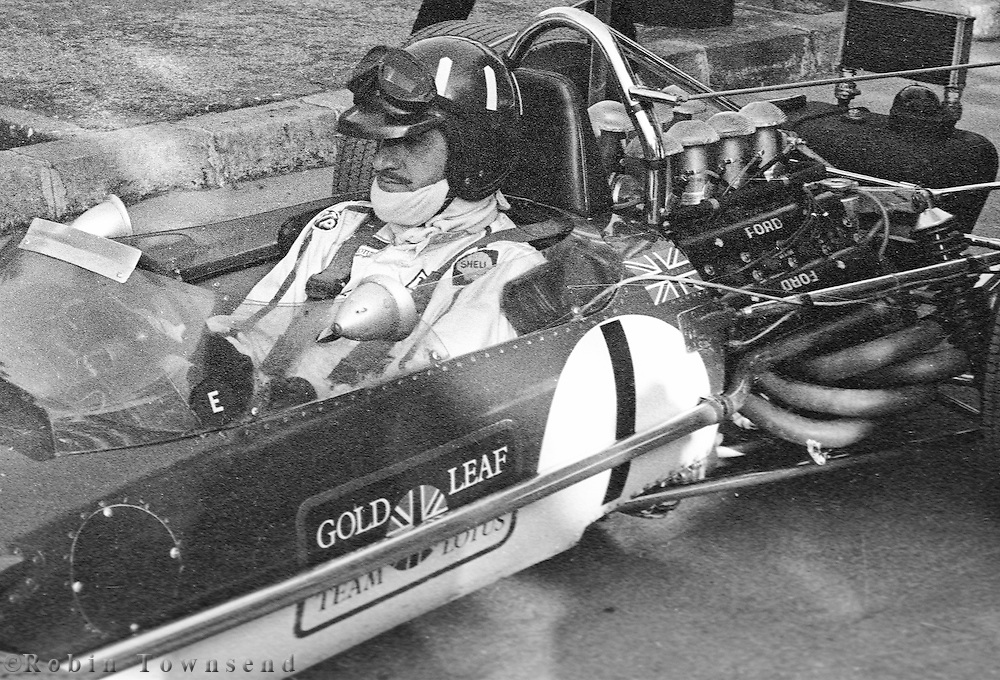 British Lotus driver, Graham Hill in his car  before the training session during the 1969 Spanish Grand Prix at the Montjuïc urban circuit in Barcelona, Spain.