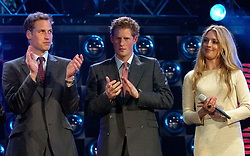 File photo dated 20/5/2006 of Princes William and Harry on stage alongside Cat Deeley at the at the Prince's Trust 30th Birthday concert at the Tower of London.