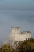 LES ANDELEYS, FRANCE - OCTOBER 10: View of the embossed ramparts and the keep of the Chateau Gaillard in a fog, on October 10, 2008 in Les Andelys, Normandy, France. The chateau was built by Richard the Lionheart in 1196, came under French control in 1204 following a siege in 1203. It was later destroyed by Henry IV in 1603 and classified as Monuments Historiques in 1852. (Photo by Manuel Cohen)