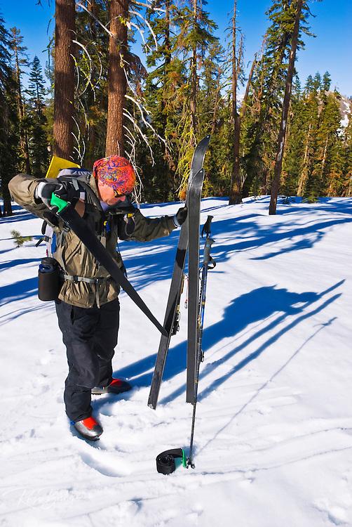 Backcountry skier removing skins near Glacier Point, Yosemite National Park, California