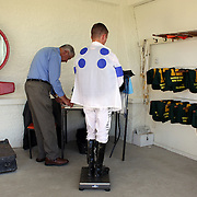 A jockey is weighed in the weighing room during a day at the Races at Ascot Park, Invercargill, Southland, New Zealand. 10th December 2011. Photo Tim Clayton