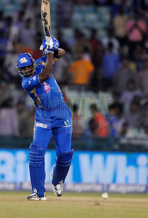 Kieron Pollard captain of Mumbai Indians  bats during the qualifier 4 match of the Oppo Champions League Twenty20 between the Mumbai Indians and the Southern Express held at the Chhattisgarh International Cricket Stadium, Raipur, India on the 14th September 2014<br /> <br /> Photo by:  Pal Pillai / Sportzpics/ CLT20<br /> <br /> <br /> Image use is subject to the terms and conditions as laid out by the BCCI/ CLT20.  The terms and conditions can be downloaded here:<br /> <br /> http://sportzpics.photoshelter.com/gallery/CLT20-Image-Terms-and-Conditions-2014/G0000IfNJn535VPU/C0000QhhKadWcjYs