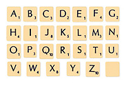 Digitally created image of a full alphabet of scrabble tiles on white background