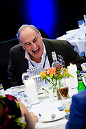 A member of the audience laughs during a keynote speech at the 2019 INSOL Europe Annual Congress. The event was held at Scandic Copenhagen<br /> <br /> © Images Copyright Copenhagen Event Photographer Matthew James