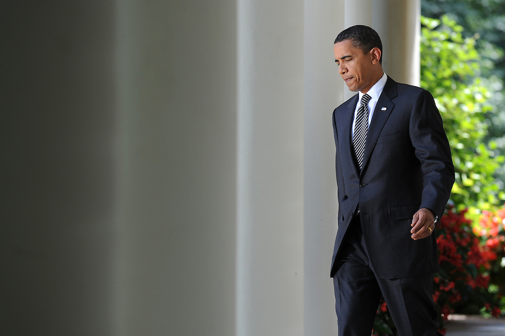 US President Barack Obama walks out to the Rose Garden to speak on Climate Change legislation at the White House in Washington, DC, USA on 25 June 2009. Obama is pushing for congressional approval of his climate change bill.