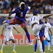 Alexander López , Haiti, is challenged by Rony Martínez, Honduras, (right), during the Haiti V Honduras CONCACAF Gold Cup group B football match at Red Bull Arena, Harrison, New Jersey. USA. 8th July 2013. Photo Tim Clayton