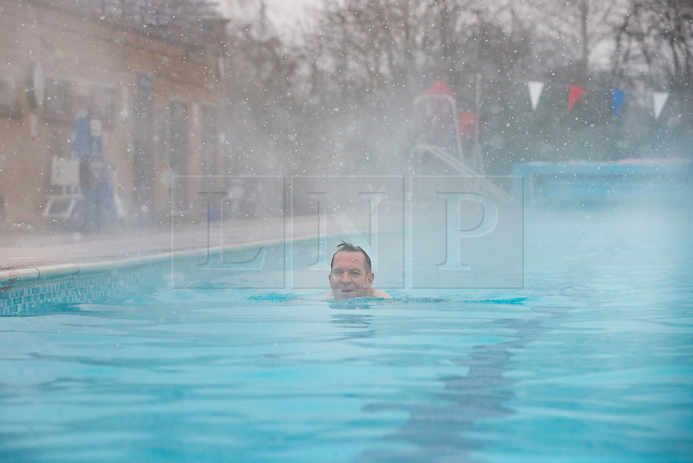 © Licensed to London News Pictures. 02/03/2018. London, UK. A swimmer braves the cold and snow at Hampton outdoor heated pool in south west London. The 'Beast from the East' and Storm Emma have brought extreme cold, ice and heavy snow to the UK. Photo credit: Peter Macdiarmid/LNP